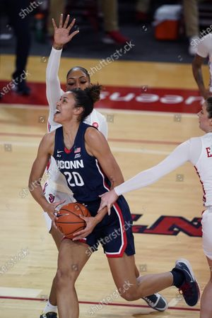 Connecticut forward Olivia Nelson-Ododa (20) is defended by St. John's forward Raven Farley, rear, as a St. John's player grabs Nelson-Ododa's arm during the second quarter of an NCAA college basketball game, in New York