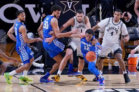 Kentucky forward Keion Brooks Jr. (12) dives for the ball ahead of Vanderbilt's Dylan Disu (1) and Jordan Wright (4) in the second half of an NCAA college basketball game, in Nashville, Tenn. Kentucky won 82-78