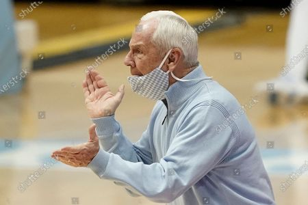 North Carolina coach Roy Williams applauds the team during the second half of an NCAA college basketball game against Northeastern in Chapel Hill, N.C
