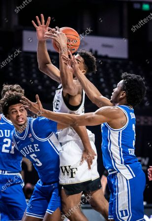Stock Picture of Wake Forest forward Isaiah Mucius grabs a rebound over Duke forward Jaemyn Brakefield (5) duirng an NCAA college basketball game, in Wintson-Salem, N.C
