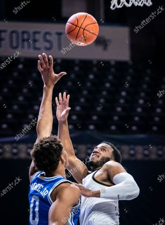 Wake Forest guard Ian DuBose (11) shoots over Duke forward Wendell Moore Jr. (0) during an NCAA college basketball game, in Wintson-Salem, N.C