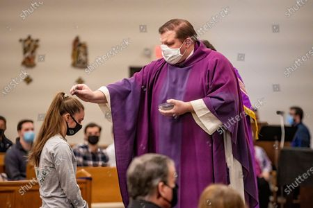 Editorial image of Ash Wednesday Mass at Christ the King University Parish in Athens, US - 17 Feb 2021
