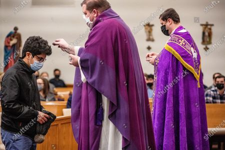 Editorial photo of Ash Wednesday Mass at Christ the King University Parish in Athens, US - 17 Feb 2021