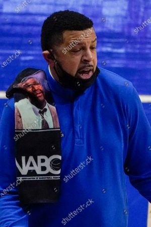 Pittsburgh head coach Jeff Capel has a towel honoring former Georgetown head coach John Thompson on his shoulder during the first half of an NCAA college basketball game against North Carolina State, in Pittsburgh