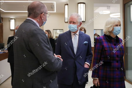 Britain's Prince Charles and Camilla Duchess of Cornwall, talk with staff during a visit at Queen Elizabeth Hospital, amid the spread of the coronavirus disease (COVID-19)
