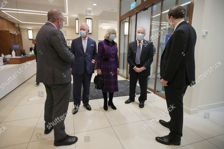 Britain's Prince Charles and Camilla Duchess of Cornwall, talk with Health Secretary Matt Hancock (R) and staff during a visit at Queen Elizabeth Hospital, amid the spread of the coronavirus disease (COVID-19)