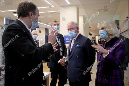 Britain's Prince Charles and Camilla Duchess of Cornwall, talk with Health Secretary Matt Hancock during a visit at Queen Elizabeth Hospital, amid the spread of the coronavirus disease (COVID-19)