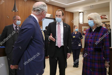 Stock Picture of Britain's Prince Charles and Camilla Duchess of Cornwall, talk with Health Secretary Matt Hancock during a visit at Queen Elizabeth Hospital, amid the spread of the coronavirus disease (COVID-19)