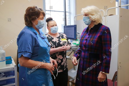 Stock Image of Camilla Duchess of Cornwall, speaks with a woman during a visit at Queen Elizabeth Hospital, amid the spread of the coronavirus disease (COVID-19)