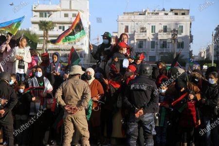 People gather in the Martyrs' Square in Tripoli, Libya, on Feb. 17, 2021. Thousands of Libyans on Wednesday celebrated the 10th anniversary of the revolution that overthrew the regime of the late leader Muammar Gaddafi in 2011.