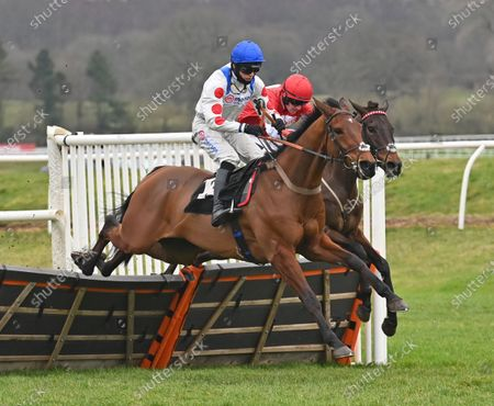(farside) Gowel Road (Sam Twiston-Davies) takes the last before going on to win The Read Paul Nicholls On Betting.Betfair Novices Hurdle Race from (L) Good Ball (Harry Cobden).Photo © Hugh Routledge.