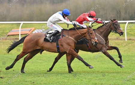 (R) Gowel Road (Sam Twiston-Davies) after taking the last and going on to win The Read Paul Nicholls On Betting.Betfair Novices Hurdle Race from (L) Good Ball (Harry Cobden).Photo © Hugh Routledge.