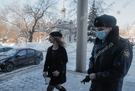 A member of the Russian rock band Pussy Riot Maria Alyokhina (L) arrives at Moscow City Court in Moscow, Russia, 18 February 2021. Moscow City Court is to consider an appeal against house arrest of Alyokhina who has been detained for allegedly violating sanitary and epidemiological rules during a rally took place on 23 January 2021.