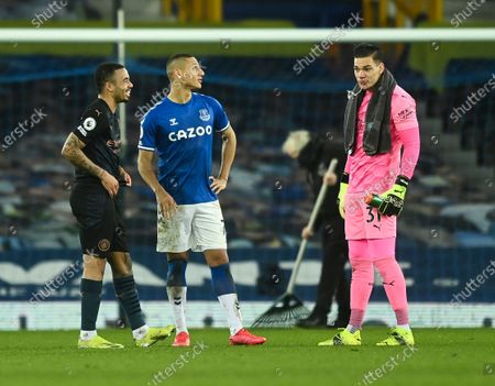 Stock Image of Richarlison of Everton with Ederson Moraes and Gabriel Jesus of Manchester City