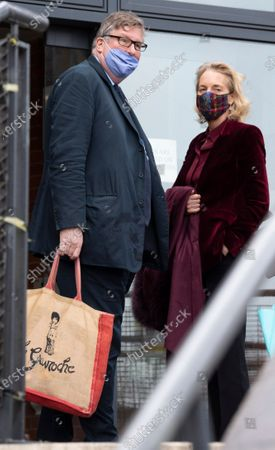 Hedge Fund manager Crispin Odey arrives at Hendon Magistrates with wife Nichola Pease this morning for the start of his assault trial