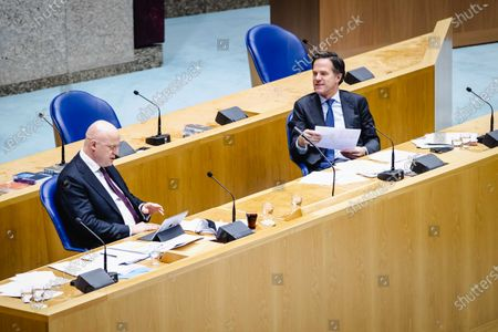 Dutch Justice Minister Ferdinand Ferdinand Grapperhaus (L) and Prime Minister Mark Rutte (R) during the debate on the new emergency law on the curfew, in the Senate, in The Hague, The Netherlands, 18 February 2021. The Dutch cabinet brought up the new law within a day, after the court in The Hague declared the curfew invalid.