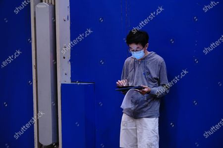 A person using his computer at a subway station in Main St., Flushing in Queens as New York City continues Phase 4 of re-opening following restrictions imposed to slow the spread of coronavirus on August 20, 2020 in New York City. The fourth phase allows outdoor arts and entertainment, sporting events without fans and media production.