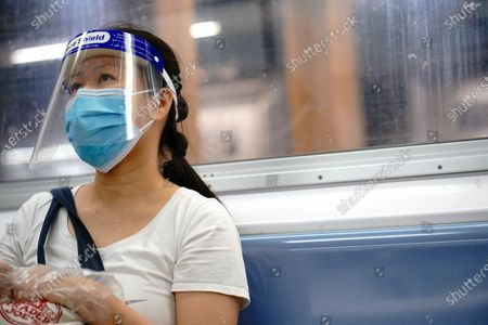 An MTA commuter wearing a mask and a face shield as protection from Coronavirus as New York City continues Phase 4 of re-opening following restrictions imposed to slow the spread of coronavirus on August 20, 2020 in New York City. The fourth phase allows outdoor arts and entertainment, sporting events without fans and media production.