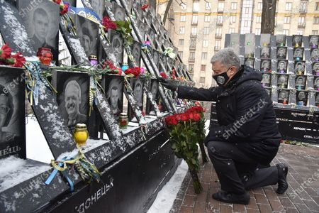 Ex-President of Ukraine, leader of the European Solidarity Party Petro Poroshenko lays flowers at the portraits of the killed Maidan activists in the Heavenly Hundred Heroes alley , Kyiv, capital of Ukraine.