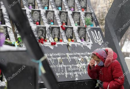 A woman praying in front of the Heavenly Hundred monument during the anniversary. Ukrainians commemorated the 7th anniversary of the eruption of the Euro Maidan revolution, an uprising against the government of the then Ukrainian President Viktor Yanukovych, in which at least 100 protestors died.