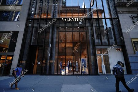 Manhattan enters Phase 2 of re-opening following restrictions imposed to curb the coronavirus pandemic on June 22, 2020 in New York City. Phase 2 permits the reopening of offices, in-store retail, outdoor dining, barbers and beauty parlors and numerous other businesses. Phase 2 is the second of four-phased stages designated by the state. Valentino sues NYC landlord to get out of 5th Ave lease amid pandemic.