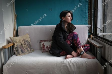 Turkish Clinical Psychologist Melis sits in her balcony during her home arrest after she protested against students arrest in Istanbul, Turkey, 13 February 2021 (Issued 18 February 2021). According to the Turkish Interior Ministry, 528 people were detained in 38 different cities between January 4 and February 4 in relation with the Bogazici University protests.11 protesters were arrested and 24 people were sentenced to home detention with ankle monitors. The protesters had initially started demonstrating again the appointment of a new rector close to President Recep Tayyip Erdogan at the Bogazici University, contrary to what used to be an election process. More protests followed after strong condemning reactions by conservatives and radical groups against an LGBT event which featured an image of the Muslim's holy site the Kaaba, took place at the university on 29 January.
