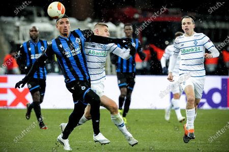 Brugge's Nabil Dirar (L) in action against Dynamo's Vitali Mykolenko (C) during the UEFA Europa League round of 32 first leg soccer match between FC Dynamo Kyiv and Club Brugge in Kiev, Ukraine, 18 February 2021.