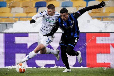 Dynamo's Vitali Mykolenko (L) in action against Brugge's Nabil Dirar (R) during the UEFA Europa League round of 32 first leg soccer match between FC Dynamo Kyiv and Club Brugge in Kiev, Ukraine, 18 February 2021.