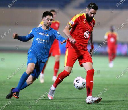 Al-Qadisiyah's player Rhys Williams (R) in action against Al-Nassr's Gonzalo Martinez (L) during the Saudi Professional League soccer match between Al-Qadisiyah and Al-Nassr at Prince Saud Bin Jalawy Stadium, in Al-Khobar, Saudi Arabia, 18 February 2021.