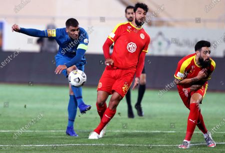 Al-Qadisiyah's players Rhys Williams (R) and Uros Vitas (C) in action against Al-Nassr's Abderazak Hamdallah (L) during the Saudi Professional League soccer match between Al-Qadisiyah and Al-Nassr at Prince Saud Bin Jalawy Stadium, in Al-Khobar, Saudi Arabia, 18 February 2021.