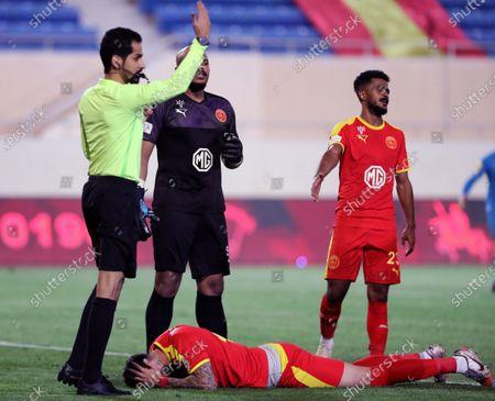 Al-Qadisiyah's player Rhys Williams (down) lies injured as Saudi referee Faisal Alblwi calls for the medical staff during the Saudi Professional League soccer match between Al-Qadisiyah and Al-Nassr at Prince Saud Bin Jalawy Stadium, in Al-Khobar, Saudi Arabia, 18 February 2021.