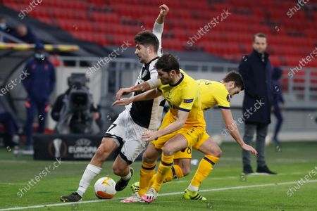 Wolfsberger's Michael Novak challenges for the ball with Tottenham's Harry Winks, right, during the Europa League round of 32, first leg, soccer match between Wolfsberger AC and Tottenham Hotspur at the Puskas Arena stadium in Budapest, Hungary
