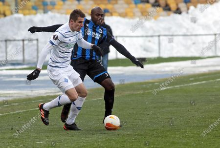 Forward Artem Besedin (L) of FC Dynamo Kyiv is seen in action with midfielder Eder Balanta (R) of Club Brugge KV during the UEFA Europa League Round of 32 1st leg game at the NSC Olimpiyskiy, Kyiv, capital of Ukraine.