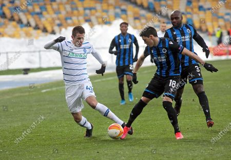Forward Artem Besedin (L) of FC Dynamo Kyiv is seen in action with defender Federico Ricca (2nd R) and midfielder Eder Balanta (R) of Club Brugge KV during the UEFA Europa League Round of 32 1st leg game at the NSC Olimpiyskiy, Kyiv, capital of Ukraine.