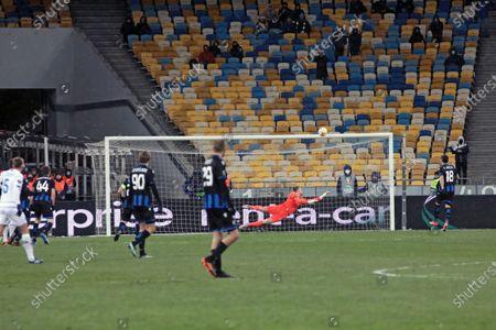 Goalkeeper Simon Mignolet of Club Brugge KV misses the goal from midfielder Vitaliy Buyalskiy of FC Dynamo Kyiv during the UEFA Europa League Round of 32 1st leg game at the NSC Olimpiyskiy, Kyiv, capital of Ukraine.