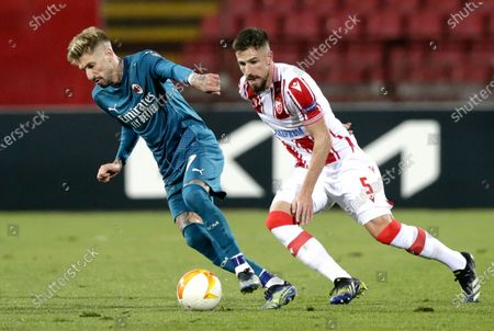 Milan's Samuel Castillejo (L) in action against Red Star's Milos Degenek (R) during the UEFA Europa League round of 32, first leg soccer match between Red Star Belgrade and AC Milan in Belgrade, Serbia, 18 February 2021.