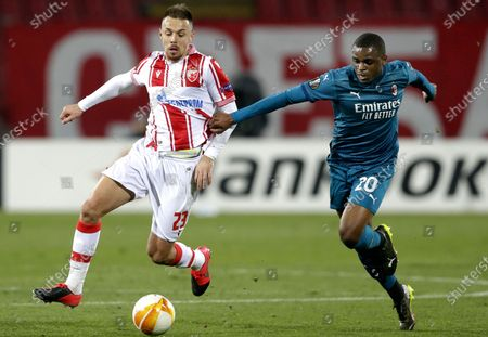 Red Star's Milan Rodic (L) in action against Milan's Pierre Kalulu (R) during the UEFA Europa League round of 32, first leg soccer match between Red Star Belgrade and AC Milan in Belgrade, Serbia, 18 February 2021.