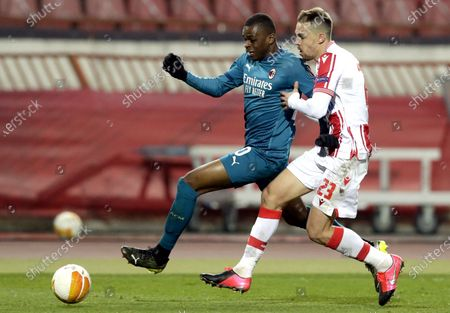 Milan's Pierre Kalulu (L) in action against Red Star's Milan Rodic (R) during the UEFA Europa League round of 32, first leg soccer match between Red Star Belgrade and AC Milan in Belgrade, Serbia, 18 February 2021.