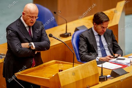 Ferdinand Grapperhaus, outgoing Minister of Justice and Security, and outgoing Prime Minister Mark Rutte during the debate in the House of Representatives about the new emergency law on the curfew. The cabinet turned up the new law within a day, after the court in The Hague declared the curfew invalid.