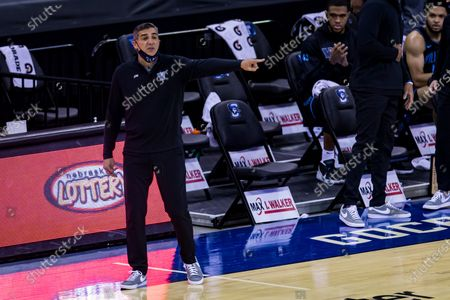 Villanova head coach Jay Wright reacts to the action on the court against Creighton during the first half of an NCAA college basketball game, in Omaha, Neb