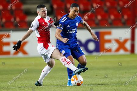 Slavia's Nicolae Stanciu, left, and Leicester's Youri Tielemans challenge for the ball during the UEFA Europa League round of 32 first leg soccer match between AC Sparta Praha and Leicester City in Prague, Czech Republic