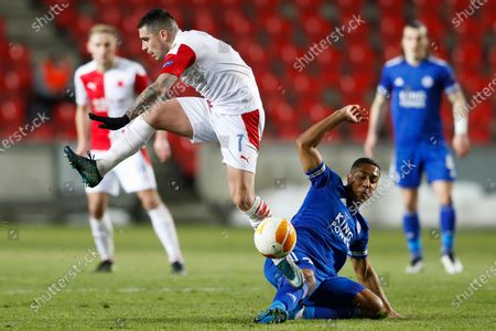 Slavia's Nicolae Stanciu, left, and Leicester's Youri Tielemans, right, challenge for the ball during the UEFA Europa League round of 32 first leg soccer match between AC Sparta Praha and Leicester City in Prague, Czech Republic