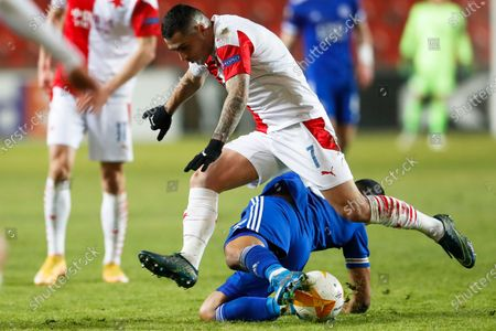 Slavia's Nicolae Stanciu, top, and Leicester's Youri Tielemans, on the ground, battle for the ball during the UEFA Europa League round of 32 first leg soccer match between AC Sparta Praha and Leicester City in Prague, Czech Republic