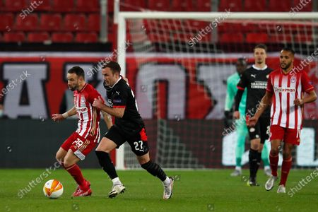 Olympiacos' Mathieu Valbuena, left, duel for the ball with PSV's Mario Goetze during a Europa League, round of 32, first leg soccer match, between Olympiacos and PVS at Georgios Karaiskakis stadium in Piraeus port, near Athens