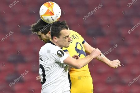 Harry Winks (back) of Tottenham in action against Dario Vizinger (front) of Wolfsberg during the UEFA Europa League round of 32, first leg soccer match between Wolfsberger AC and Tottenham Hotspur at the Puskas Arena stadium in Budapest, Hungary, 18 February 2021.