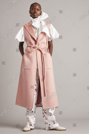 Stock Photo of A Model wearing an outfit from the Womens Ready to wear, pret a porter, collections, winter 2021 2022, original creation, during the Womenswear Fashion Week in New York, from the house of Adam Lippes