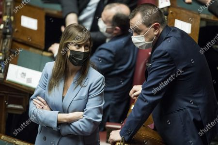 """Deputies of """"Italia Viva"""" party, Maria Elena Boschi and Ettore Rosato, at the Chamber of Deputies for a confidence vote on the Italian Prime Minister Mario Draghi government in Rome, Italy, 18 February 2021. The new government faced a vote of confidence in the Senate on 17 February and later another vote in the lower chamber on 18 February. Premier Mario Draghi and his new cabinet were sworn in before President Sergio Mattarella on 13 February 2021. The executive led by the former president of the European Central Bank is a sort of government of national unity assembled to prevent the country having to hold early elections in the middle of the COVID-19 pandemic following the collapse of ex-premier Giuseppe Conte's administration."""