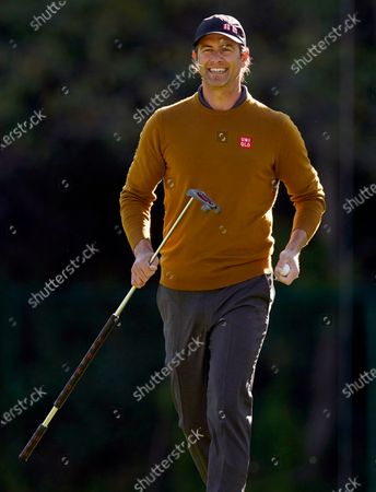 Adam Scott, of Australia, reacts after a birdie putt on the 13th hole during the first round of the Genesis Invitational golf tournament at Riviera Country Club, in the Pacific Palisades area of Los Angeles