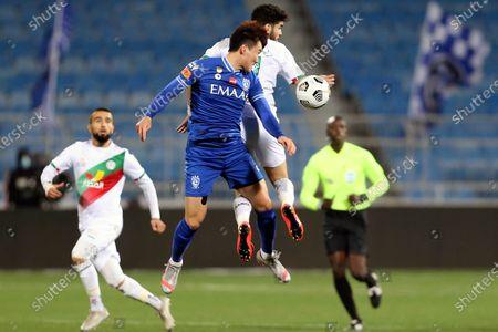 Al-Hilal's player Hyun Soo Jang (front) in action against Al-Ettifaq's Walid Azarou (back) during the Saudi Professional League soccer match between Al-Hilal and Al-Ettifaq at Prince Faisal Bin Fahd Stadium, in Riyadh, Saudi Arabia, 18 February 2021.