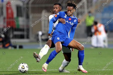 Al-Hilal's player Andre Carrillo (front) in action against Al-Ettifaq's Fahad Ghazi (back) during the Saudi Professional League soccer match between Al-Hilal and Al-Ettifaq at Prince Faisal Bin Fahd Stadium, in Riyadh, Saudi Arabia, 18 February 2021.